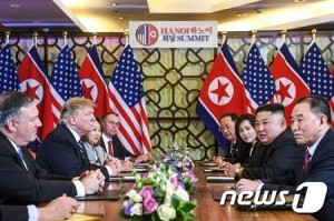 US President Donald Trump (2nd L) and North Korea's leader Kim Jong Un (2nd R) hold a bilateral meeting during the second US-North Korea summit at the Sofitel Legend Metropole hotel in Hanoi on February 28, 2019. (Photo by Saul LOEB / AFP)